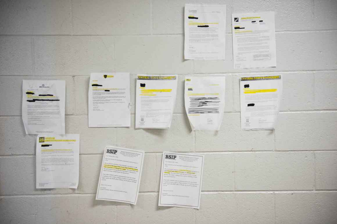 Because bulletin board space at Beecher High School is precious, students' college acceptance letters adorn the school's cinder-block walls.