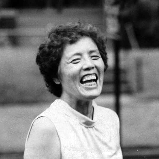 Black and white image of activist Grace Lee Boggs laughing
