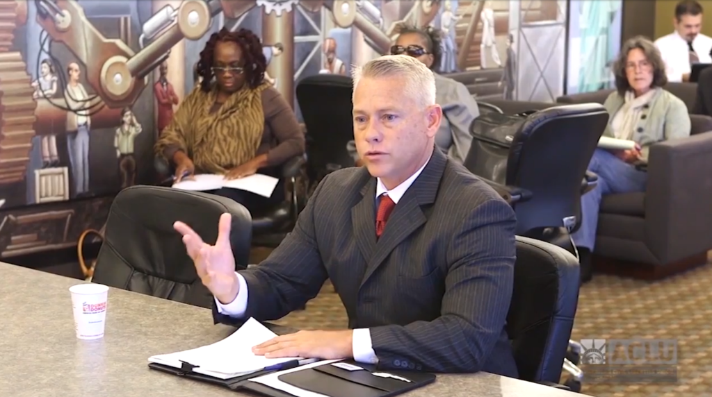 Former Kalamazoo Police Chief Jeff Hadley, shown speaking at an ACLU of Michigan public hearing on policing, led efforts to address racial bias among police that received national recognition.