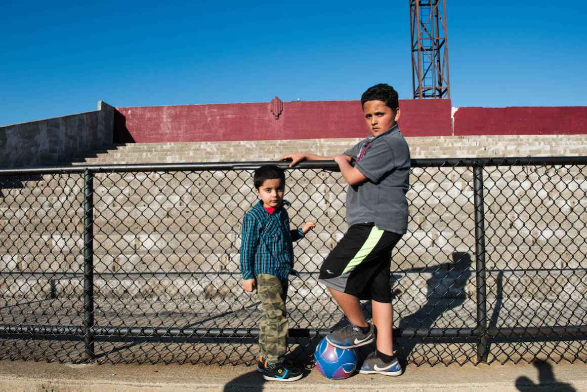 Brothers, Hamed and Kaled Korin, who attend Hamtramck Public Schools. The bleachers for the school district's main sports stadium are largely off-limits, due to insufficient funding to repair crumbling concrete.