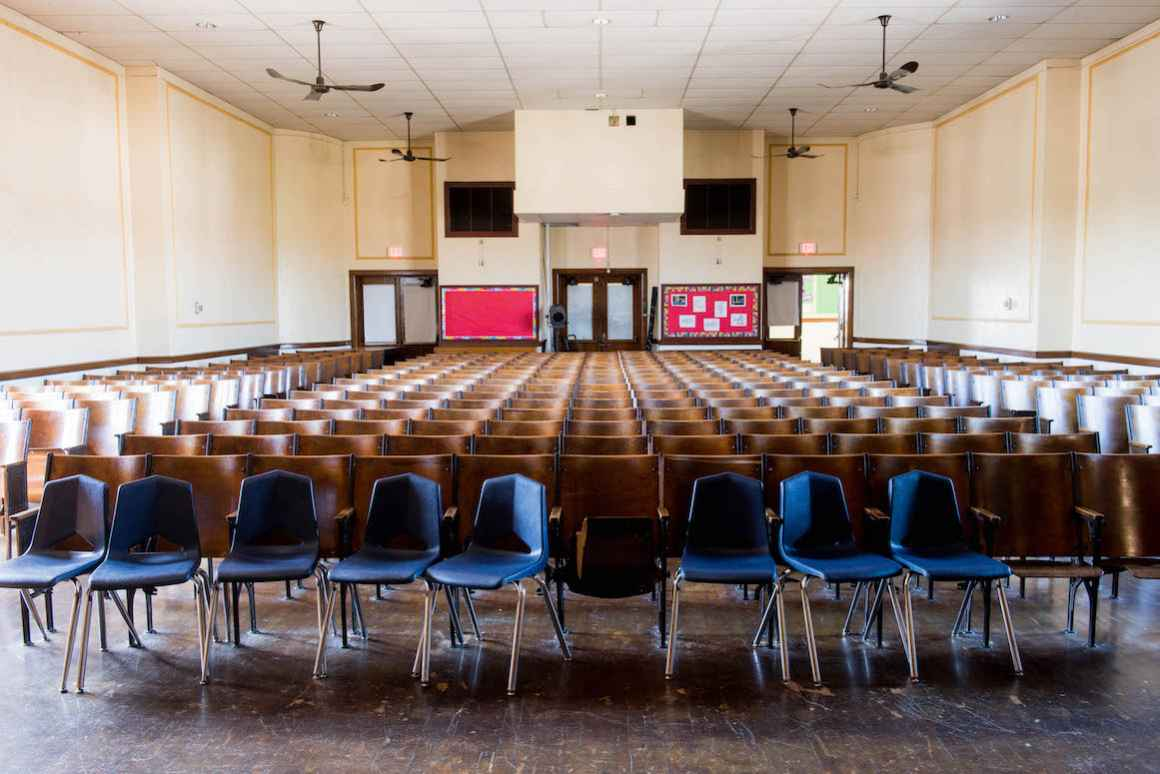 Teachers and administration at Kosciuszko Middle School take pride in the beauty of their building's auditorium. However, as the district lacks funding to make basic repairs, instead of antique wooden chairs, they have been supplemented with plastic ones