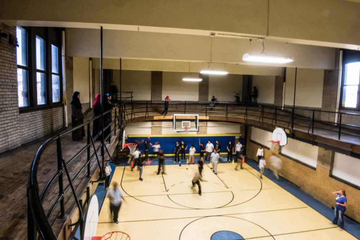 Elementary and middle-school students at the Hamtramck school building shared by the Dickinson West and Koscuizko schools play inside a small, aging gymnasium that was constructed in 1919.