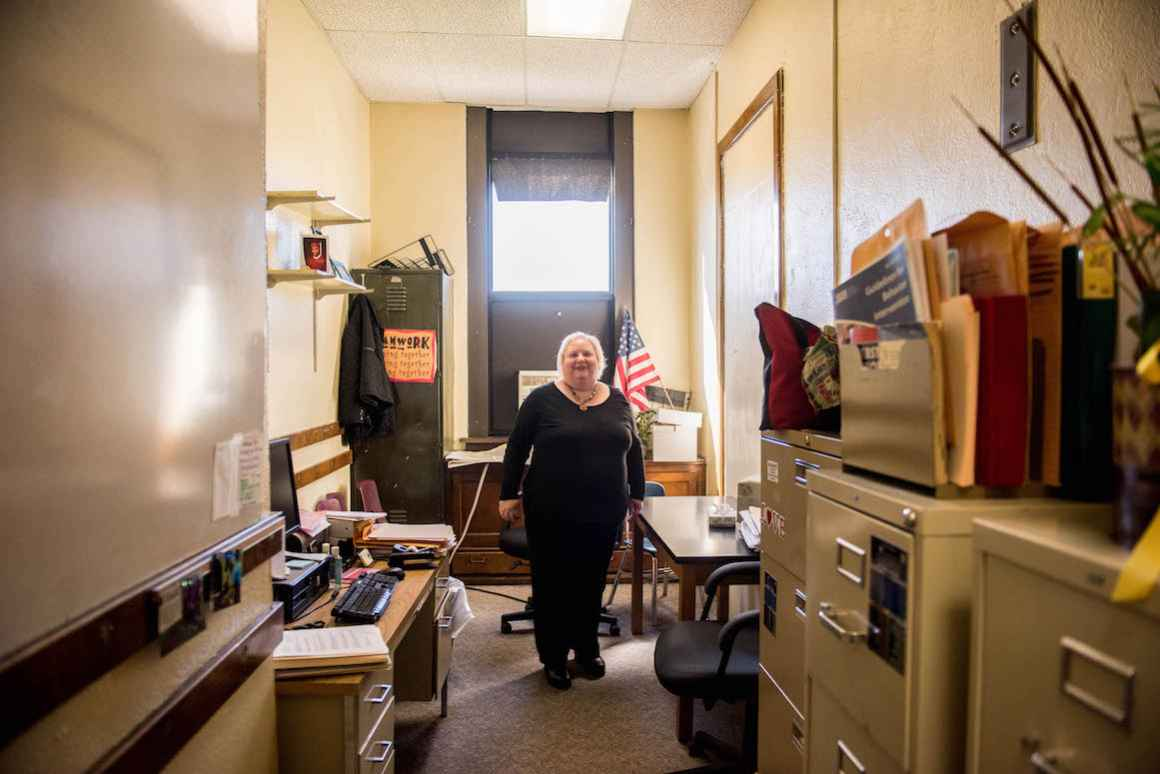 Janice Gandelman makes due with her office, a converted coat closet, at Dickinson West Elementary.