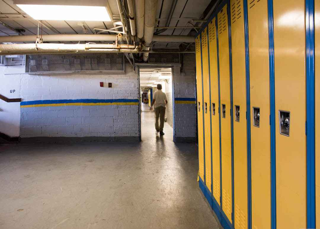 The hallway that connects Dickinson West Elementary School with Kosciuszko Middle School reveals the marks of decay characteristic of any under-maintained building without the proper funds to fix floor tiles and repaint surfaces.