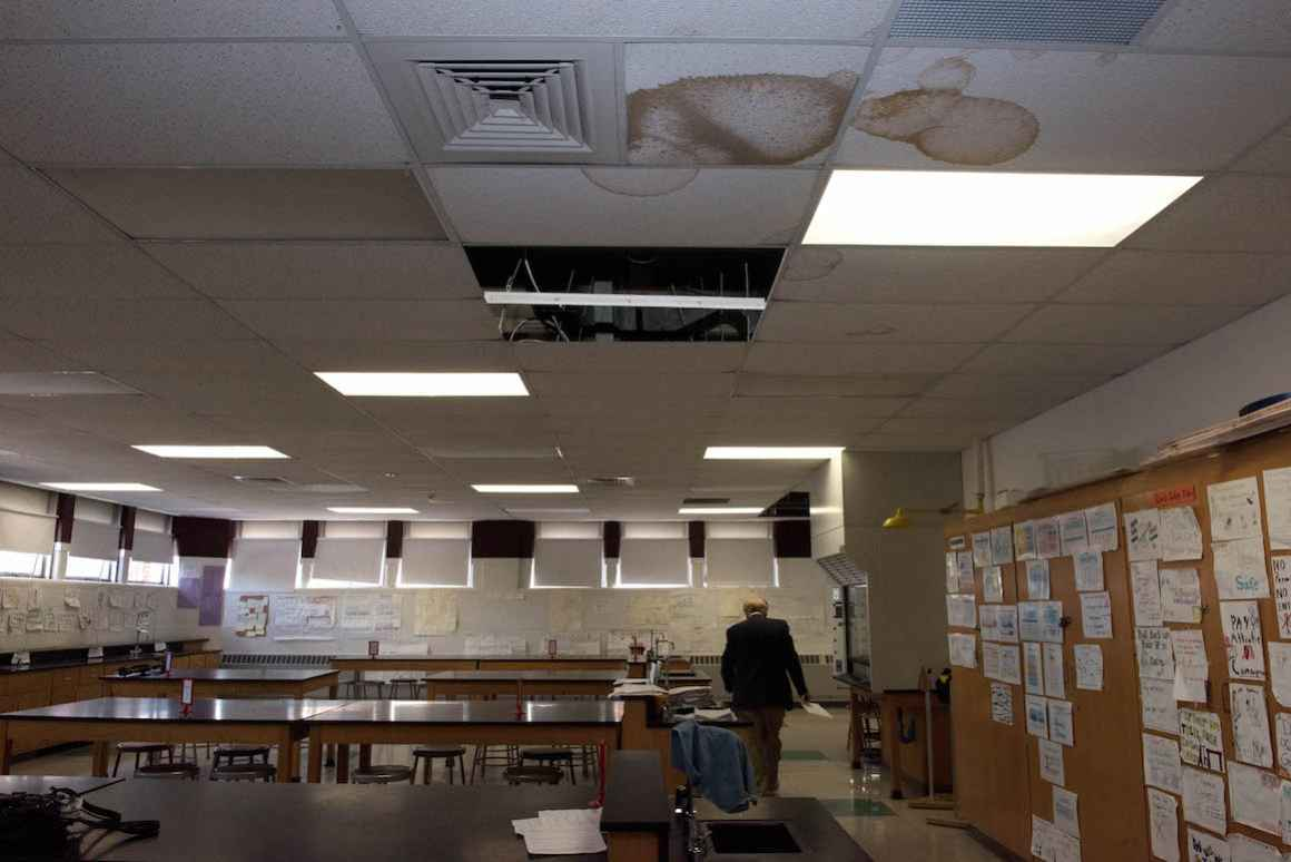 A science lab at Hamtramck High School is decorated proudly with student work, but marred by the scars of multiple roof leaks.