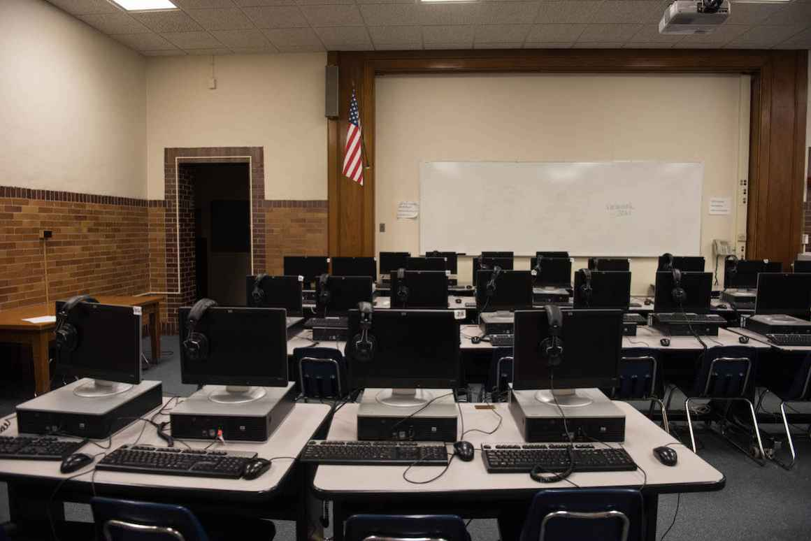 Nelson Elementary School's computer lab was built by transforming the school's old auditorium. Sweltering temperatures inside the school, stemming from the school's outdated heating system, can make storing the computers a hassle.