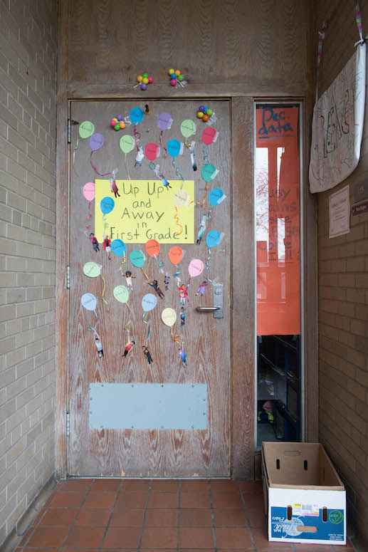 At Nelson Elementary School, decorations bearing children's names adorn old doors in need of refinishing.