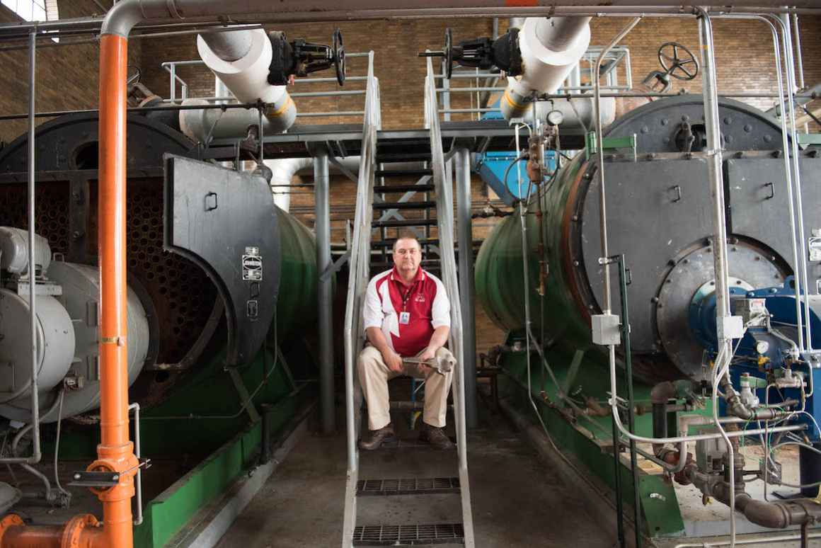 Buildings and Maintenence Director, Sam Witheiss in the schools old, but operational boiler room.