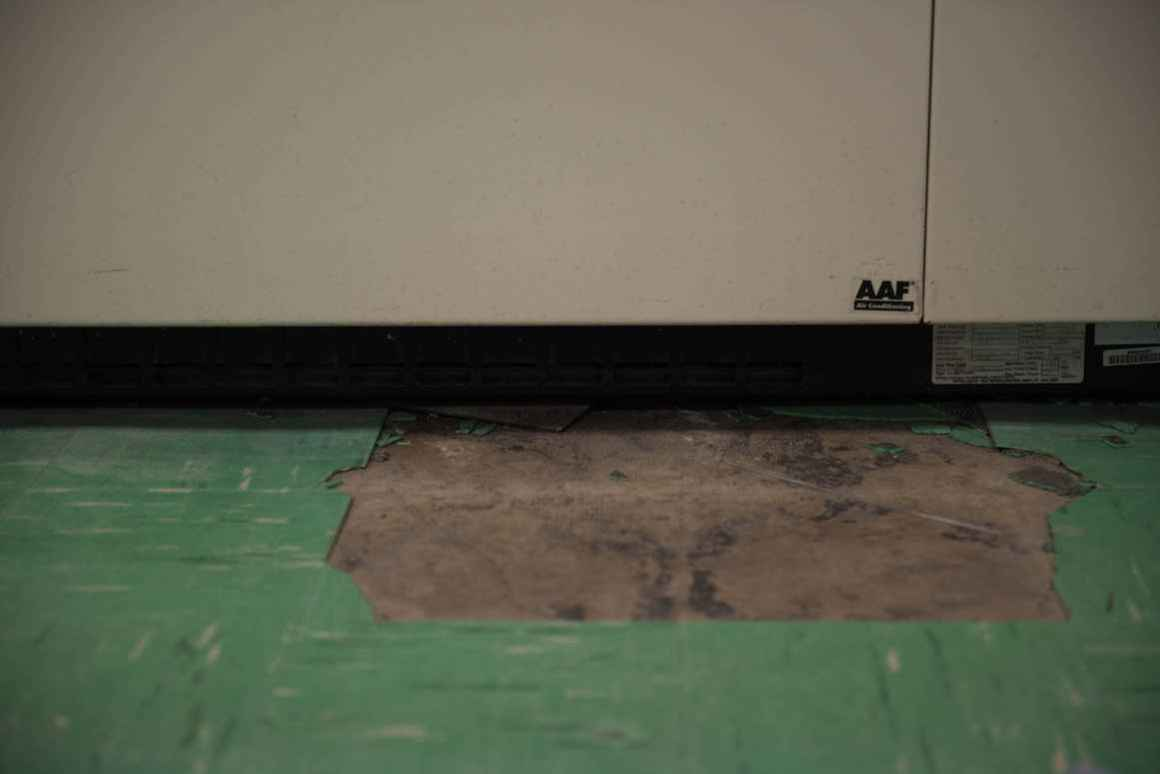 In some of the school's classrooms, the flooring is coming apart at the seams. The floor tiles contain asbestos, and mitigation adds to the cost of replacement.