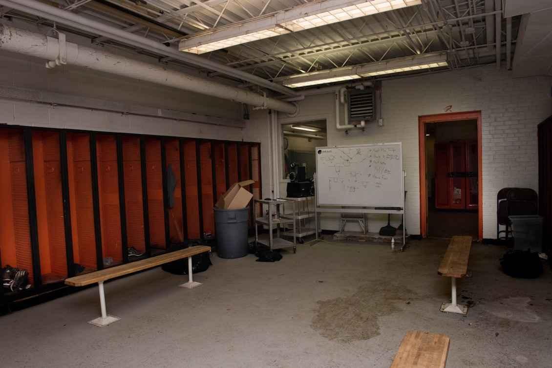 The high-school boys' locker room is in desperate need of renovation.