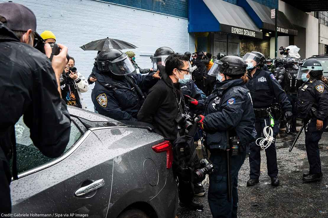 A photojournalist is arrested by NYPD officers during an anti-Trump protest in New York City