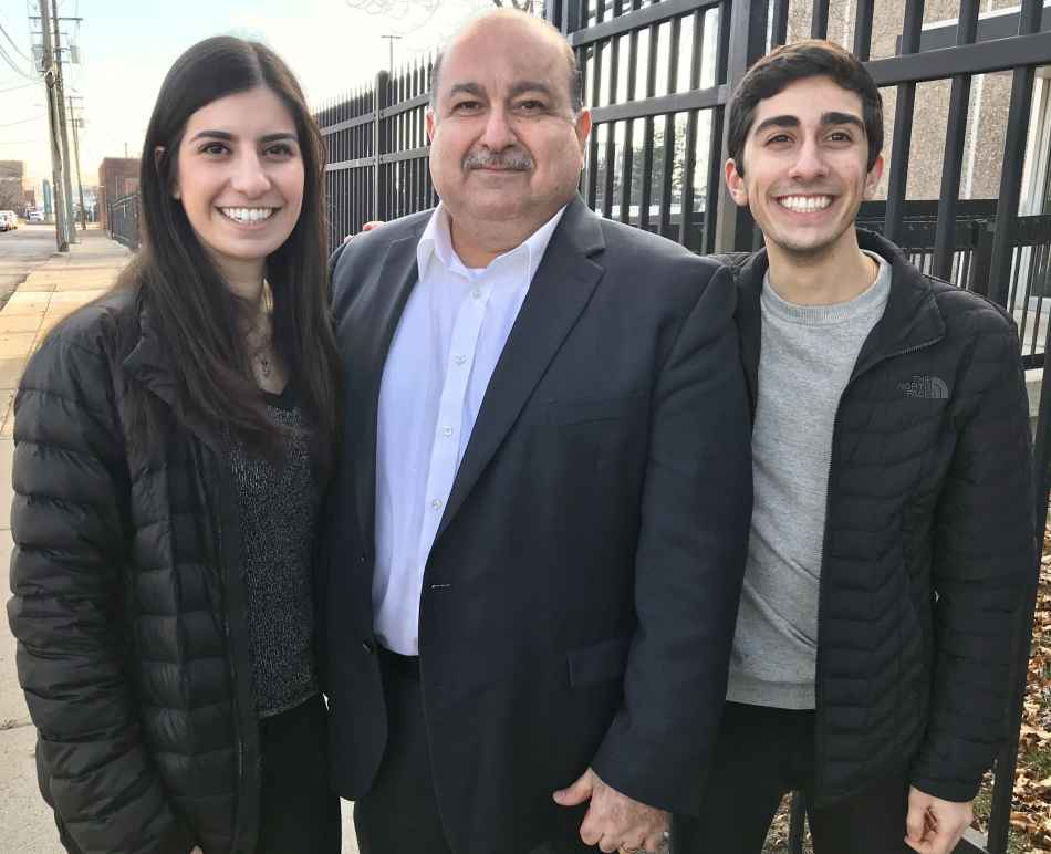 Sam Hamama standing with his daughter and son