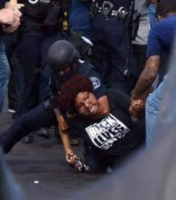 Protestor being handcuffed