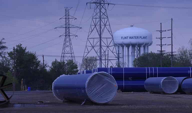 Wide picture of Flint water tower and plant
