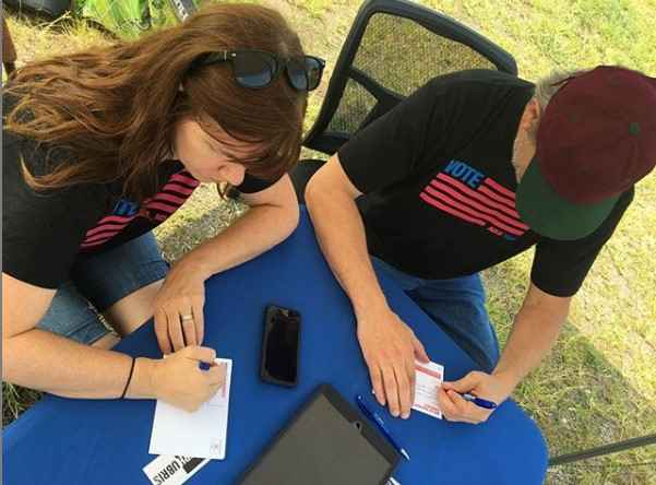 people signing up to volunteer for petition drives