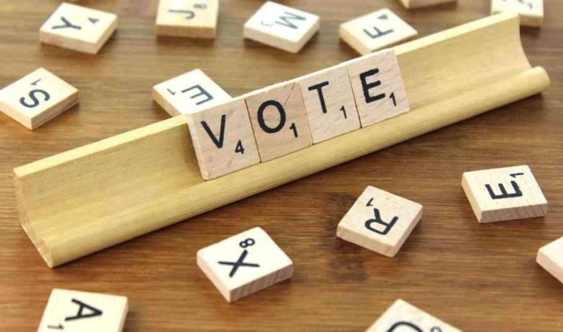 "Scrabble tiles that read ""Vote"""