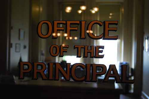 A glass door that says Office of the Principle