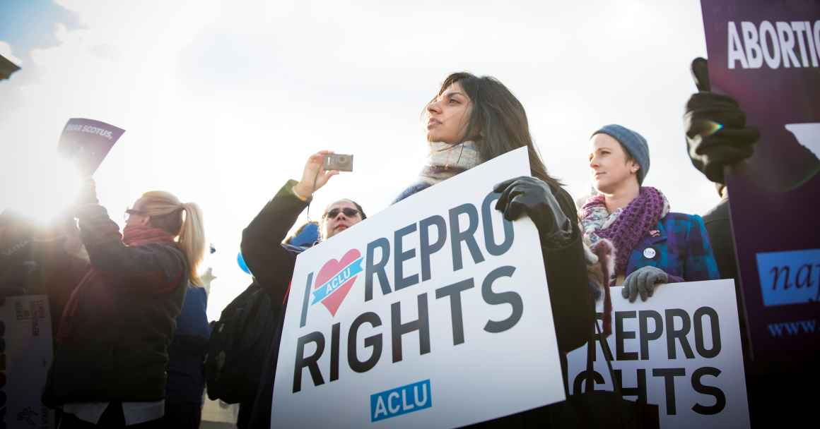 Activist protesting for reproductive rights at the Supreme Court